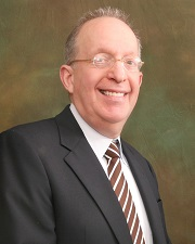 Dr. Fred Rosenberg, President and Chairman of the Board
