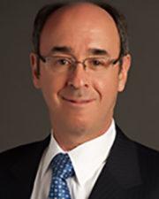 Dr. Charles M. Schron